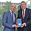 President Jörg Hacker presents Minister Councellor Klaus Famira of the Austrian Embassy with a Leopoldina medallion.